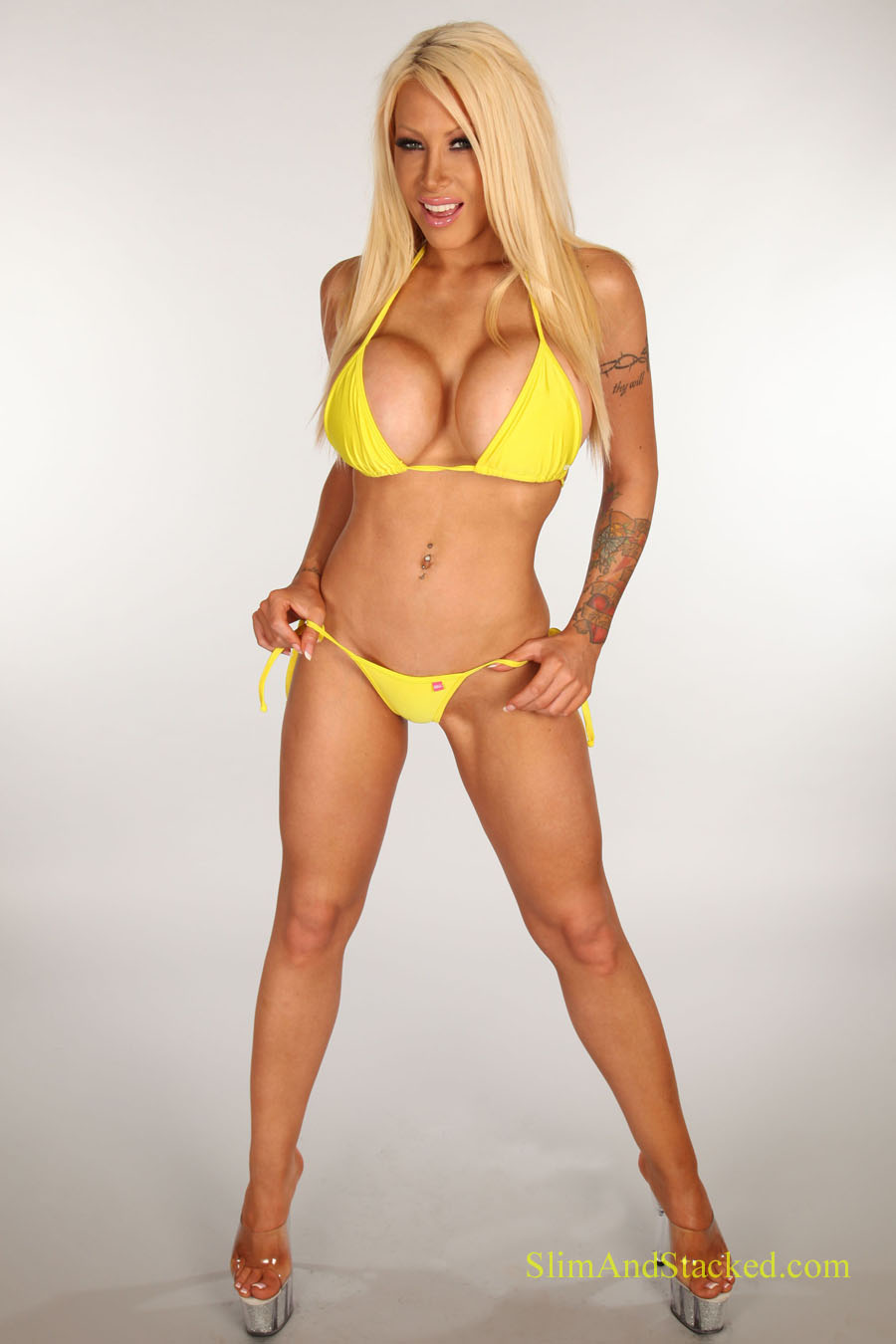 Candy Manson looks incredible in a yellow bikini.  She looks even hotter out of it.  Get a full set of Candy, in ultra high 3000 piexel resolution.  Contact dezertimagez@gmail.com for pricing
