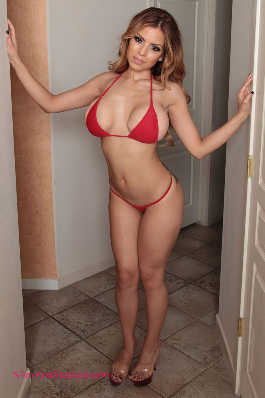 Actress and feature dancer Yurizan Beltran is smoking hot in a tiny red bikini.  And she gets even hotter when her bikini top comes off.  Get the entire set in ultra high quality, 3000 pixel resolution by contacting dezertimagez@gmail.com for pricing.