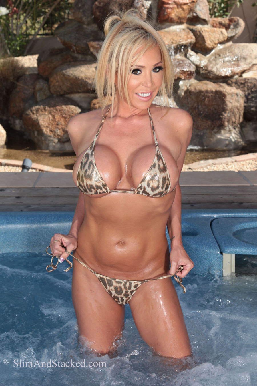 Mary Carey is smokin' hot in a tiny animal print bikini.  And she gets even hotter when her little top comes off!  See for yourself in ultra high quality, 3000 pixel resolution by owning the entire set.  Email dezertImagez@gmailcom for pricing.