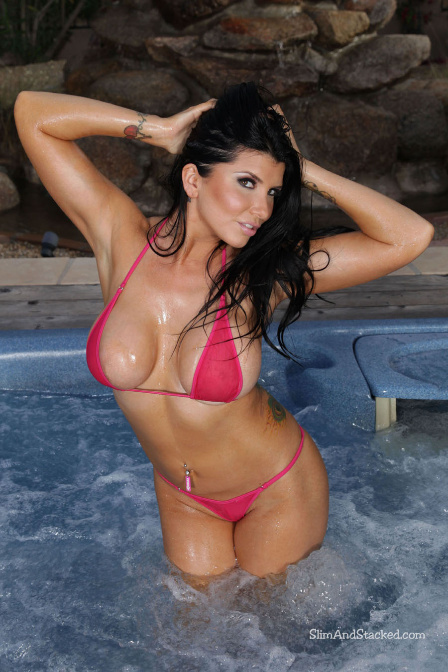 "We're excited to release this new set featuring smouldering brunette Romi Rain.  Romi is indeed ""wet & wicked"" in a sheer coral bikini.  Romi gets even more wicked as she teases her tiny bikini top off.  See for yourself by owning these ultra-high quality, 3000-pixel images.  Contact dezertimagez@gmail.com for pricing."
