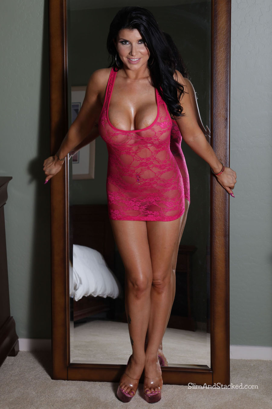 Mirror, mirror on the wall.  Is Romi Rain totally hot-hot-hot, or what?  Romi sizzles in a coral mini-dress that reveals what it barely conceals.  And she doesn't wear it for long!  See for yourself by owning this set of ultra-high resolution (3000 pixel) images.  Contact dezertimagez@gmail.com for set pricing.