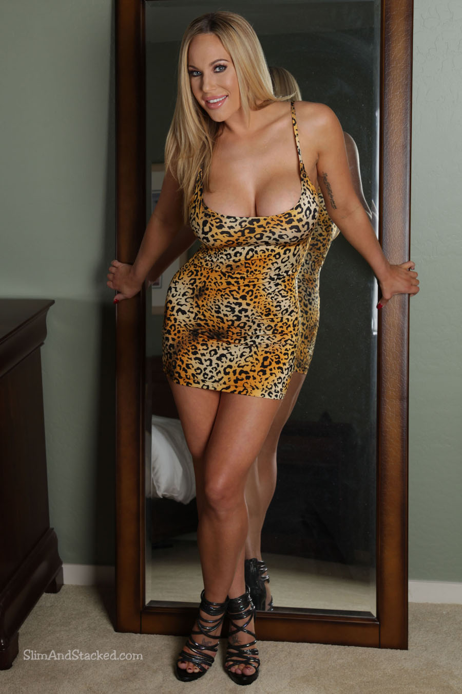 Sexy Olivia Austin is delightfully ferocious in an animal print mini-dress.  Don't you wish she'd attack you?  It's something to think about as she slowly teases that mini-dress off.  See for yourself by owning these incredible, ultra-high resolution images.  Contact dezertimagez@gmail.com for set pricing.
